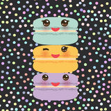 Kawaii macaroon funny orange blue lilac cookie with pink cheeks. With pink cheeks and big eyes, pastel colors on black polka dot background. Vector illustration Royalty Free Stock Photo
