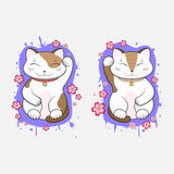 Kawaii Maneki-Neko lucky cats set of two with blooming sakura flowers Stock Photos