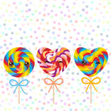 Kawaii Valentine`s Day Heart shaped candy lollipops with bow, colorful spiral candy cane with bright rainbow stripes. on stick wit Royalty Free Stock Image