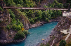 Kawarau Bridge bungy jumping. Kawarau Bridge in Queenstown is home to the world's first bungy jump. Whilst the Kawarau Gorge below featured in the Lord of the Stock Photography