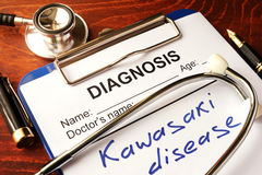 Kawasaki disease. Kawasaki disease written in a document on a table royalty free stock images