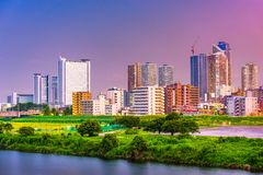 Kawasaki, Japan Skyline. Kawasaki, Japan city skyline at dusk on the Tamagawa River Stock Photography