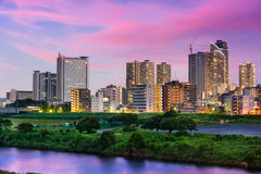 Kawasaki, Japan Skyline. On the Tamagawa river Royalty Free Stock Photos