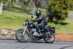 Kawasaki Motorcycle on country road. Adelaide, Australia - September 25, 2016: Vintage Kawasaki Motorcycle on country roads near the town of Birdwood, South Royalty Free Stock Photo