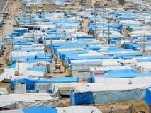 22 05 2017, Kawergosk, Iraque : O campo de refugiados abarrotado em Iraque com os refugiados que fogem de É ou estado islâmico imagens de stock