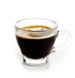 Kawowa kawa espresso w Szklanej filiżance z piankowym białym tłem Zdjęcia Royalty Free