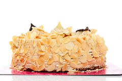 Kawowy migdału tort na białym tle obrazy stock