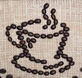 Kawowych fasoli kubek na burlap Zdjęcie Stock