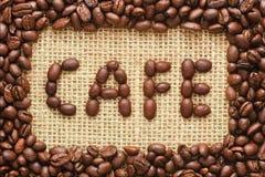 Kawowych fasoli rama z cukiernianym tekstem na grabić Obrazy Royalty Free