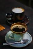 Kawy espresso kawa na stole Zdjęcia Royalty Free