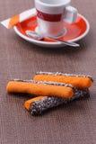 Kawy i pomarańcze kije z kokosowym zapałem Fotografia Stock