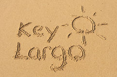 Kay Largo in the Sand. A picture of the sun and the word Key Largo drawn in the sand Royalty Free Stock Photo