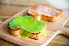 Kaya toast. The word for coconut jam in the Malay language, kaya, means rich, referencing the texture of the popular food Stock Photography