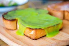 Kaya toast. The word for coconut jam in the Malay language, kaya, means rich, referencing the texture of the popular food Royalty Free Stock Images