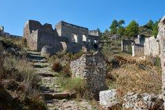 Kayaköy, antico conosciuto come Lebessos e Lebessus in Lycia Turkey Fotografie Stock Libere da Diritti