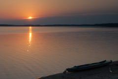 Kayak на заходе солнца Стоковое Фото