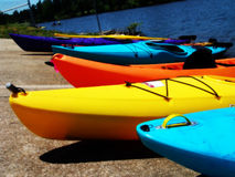 Kayak #1. Various Kayaks resting on shore of lake Royalty Free Stock Photo