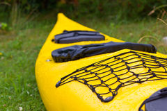 Kayak. Photograph of a kayak parked in damp green grass Stock Photos