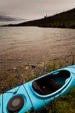 Kayak. Ready to go on lake shore Stock Photo