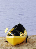 Kayak. Single yellow kayak near water royalty free stock images