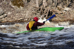 Kayak. In the deep river in the spring near a falls Royalty Free Stock Images