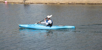 Kayak. Being paddled by man stock images