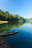 Kayak and bamboo raft in lake. Kayak and bamboo raft in Banding Lake Malaysia Stock Images