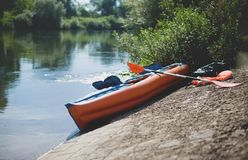 The Kayak on the Bank of River in Nature. Specifically: River Mohan in Germany. The Kayak on the Bank of River. Specifically: River Mohan in Germany Royalty Free Stock Images