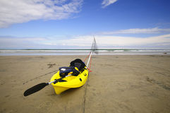 Kayak on the beach. A fishing kayak rests on the beach Stock Photo