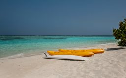 Kayak on the beach .kayaks at beautiful tropical beach with palm trees, white sand, turquoise ocean water and blue sky Stock Photo