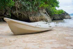 Kayak on the beach with mountains Royalty Free Stock Images