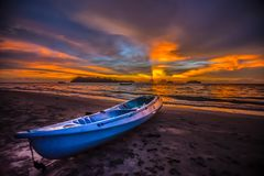 Kayak on the beach at sunset. stock photography