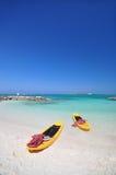 Kayak and the beautiful beach. Kayaks and the beautiful beach with blue sky stock photos