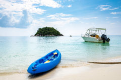 Kayak blue boat and speed boat anchor activity and white sand cr Royalty Free Stock Photo