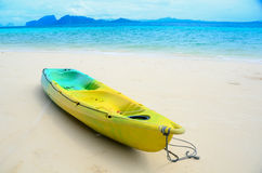 Kayak boat on the beautiful white beach Royalty Free Stock Images