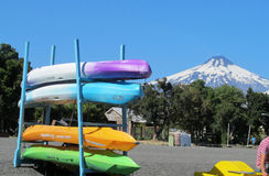 Kayak boats rent near Villarica volcano in Chile Stock Image