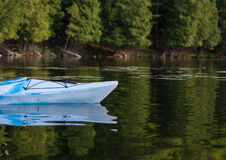 Kayak on a Calm Bay in Summertime Royalty Free Stock Image