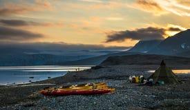 Kayak campsite near glacier in Svalbard Stock Photos