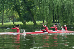 Kayak canoeist  training on the lake. The picture was taken on May 4th,2012 at the West Lake,Hangzhou,China. Some girl athletes in red  were practising with Stock Photography