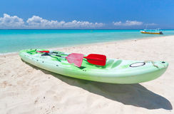 Kayak on the Caribbean beach. Kayak on the beach of Caribbean Sea of Mexico Royalty Free Stock Photos