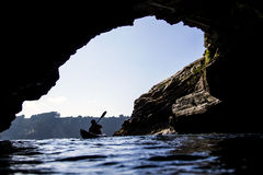 Kayak from the cave. I take this picture in Asturias, north off Spain, inside a cave in the ocean Royalty Free Stock Photography