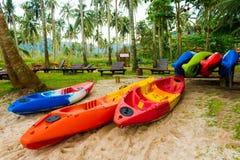 Kayak. Colorful Kayaks Heap on the beach royalty free stock photos