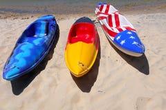 Kayak colors. Kayak boats with vivid color flags Stock Photos