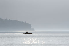 Kayak crossing a lake Stock Images