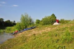 Kayak et tente Photos stock