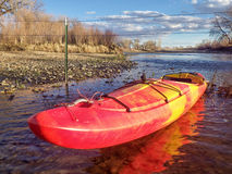 Kayak and fence across river Royalty Free Stock Images