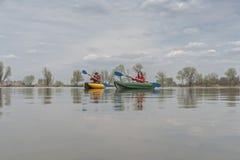 Kayak fishing at lake. Fisherwoman on inflateble boat with fishi. Ng tackle stock image
