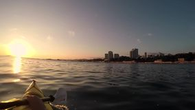 Kayak floats in the sea at sunset stock footage