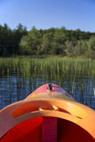Kayak front end headed into reeds in river Royalty Free Stock Photo