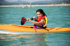 Kayak Girl. A young tween girl kayaks on Canyon Lake in the Texas Hill Country Stock Image
